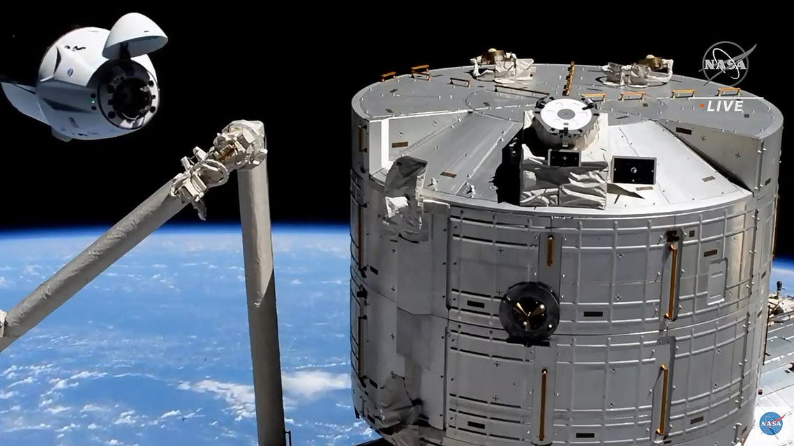 This screen grab taken from the NASA live feed shows the SpaceX's Crew Dragon spacecraft at 20 meters of the docking access of the International Space Station on April 24. A recycled SpaceX Crew Dragon capsule with four astronauts aboard, ESA (European Space Agency) astronaut Thomas Pesquet, NASA astronauts Megan McArthur and Shane Kimbrough, and Japan Aerospace Exploration Agency (JAXA) astronaut Akihiko Hoshide, was speeding on its way to the International Space Station, where the spacecraft is set to dock early Saturday. (AFP)