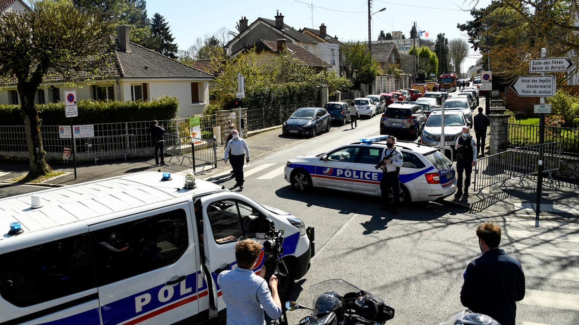 French police officials block off a street near a police station in Rambouillet, south-west of Paris, on April 23, 2021, after a woman was stabbed to death in the town. A female police employee was stabbed to death by a Tunisian man at a police station southwest of Paris on Friday, the local prosecutor's office and a police source told AFP. The attacker was fatally wounded when an officer opened fire on him at the station in Rambouillet, a wealthy commuter town about 60 kilometres from Paris, a police source told AFP.