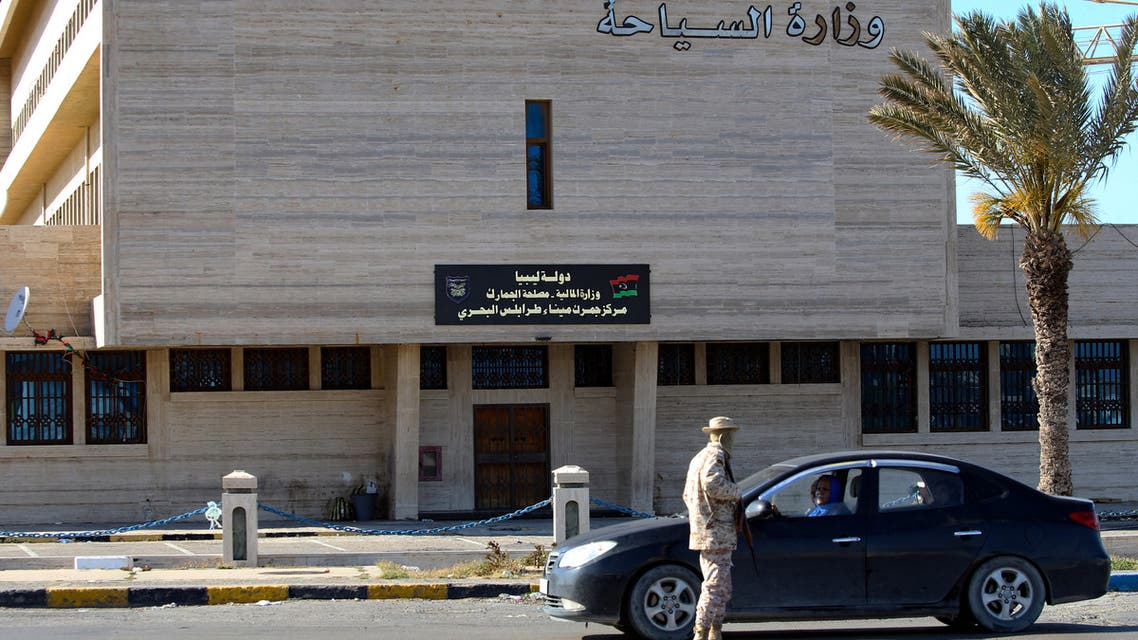 A Member of the Libyan security forces mans a checkpoint in front of the ministry of tourism in the capital Tripoli, to insure that the strict measures taken by the authorities to stem the spread of the novel coronavirus are respected, on April 10, 2020. AFP
