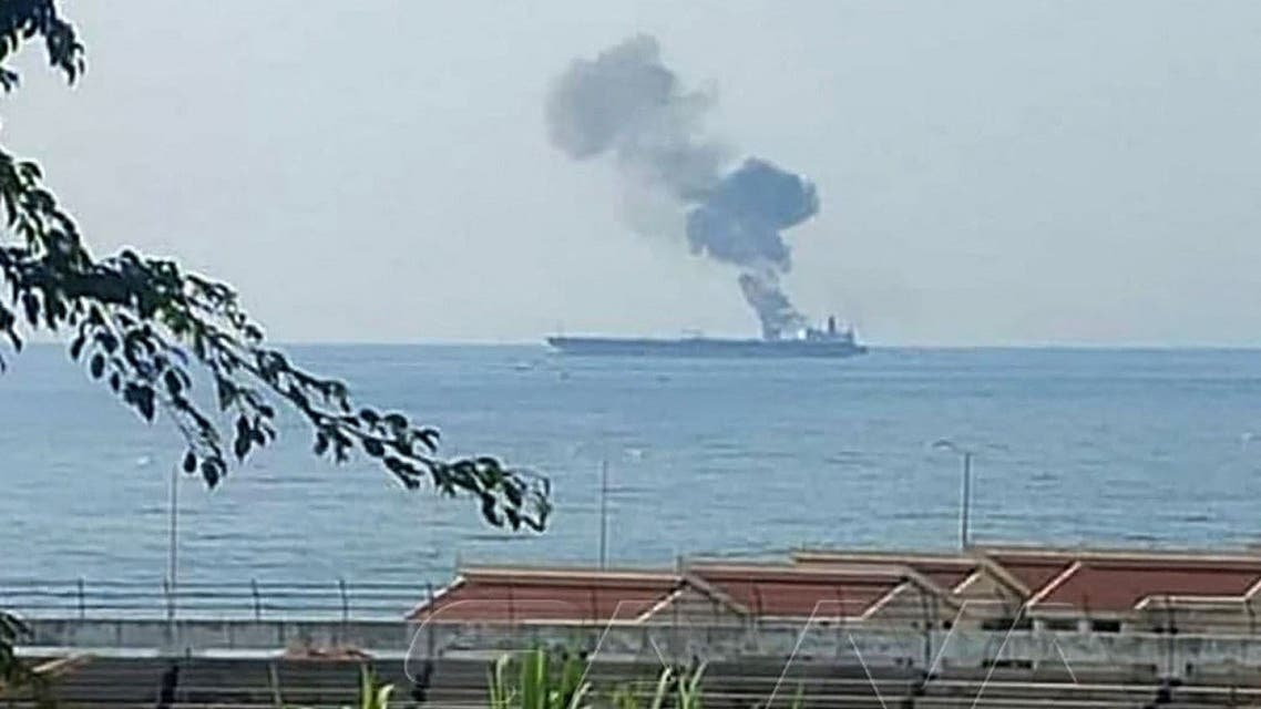 This handout picture released on April 24, 2021, shows smoke billowing from a tanker off the coast of the western Syrian city of Baniyas. (SANA/AFP)