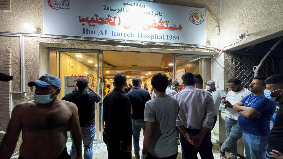 People gather at Ibn Khatib hospital after a fire caused by an oxygen tank explosion in Baghdad, Iraq, April 25, 2021. (Reuters)