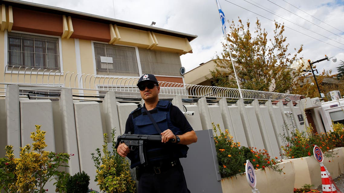 A police officer stands guard in front of the Israeli Embassy in Ankara, Turkey, September 21, 2016. (Reuters)
