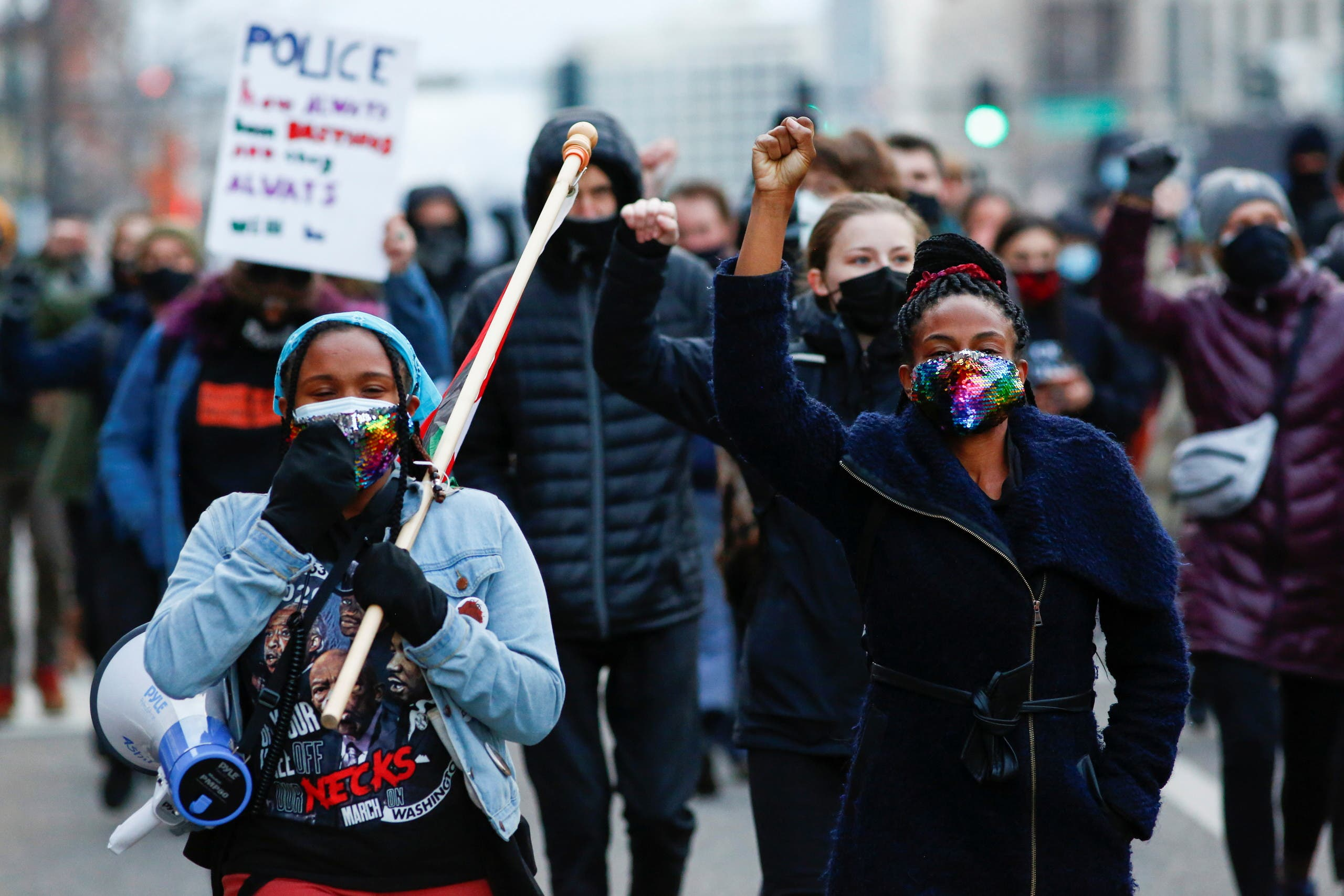 People march down Colfax Avenue during a demonstration protesting police violence after the verdict in the trial of former Minneapolis police officer Derek Chauvin, found guilty of the death of Floyd, in Denver, Colorado, US, April 20, 2021. (Reuters)