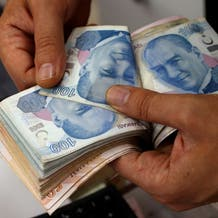Turkish lira nears record low after cenbank comment, US 'genocide' move