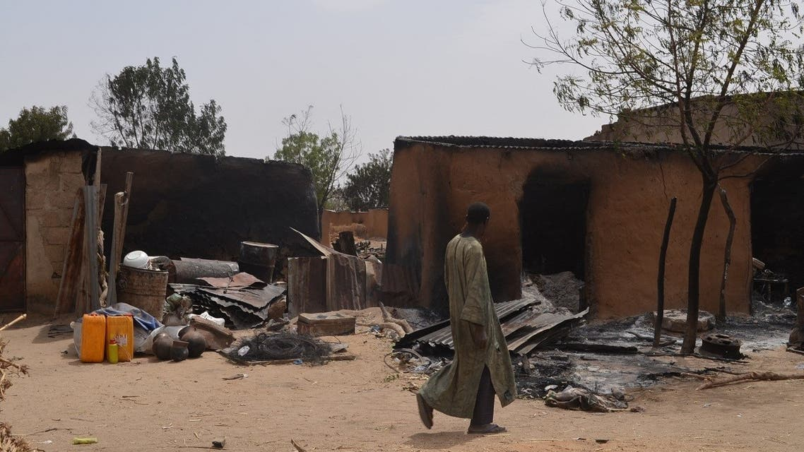 A villager walks past razed homes in Mainok, outside Maiduguri, Borno State, Nigeria. (File photo: AFP)