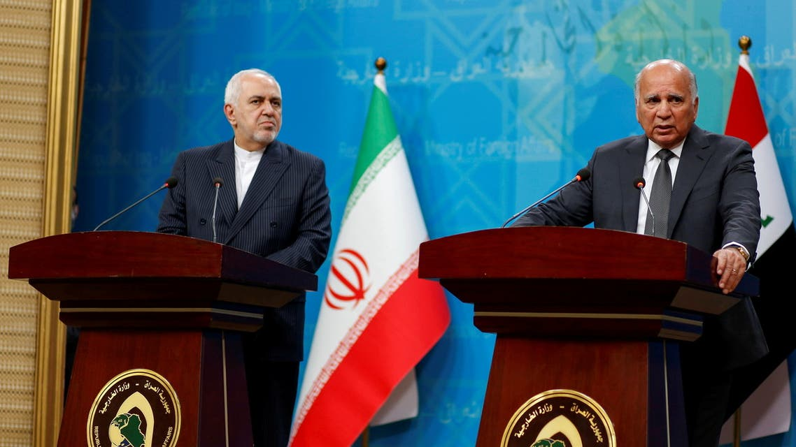 Iraqi foreign minister Fuad Hussein speaks during a joint statement with his Iranian counterpart Mohammad Javad Zarif in Baghdad, Iraq April 26, 2021. (Reuters)