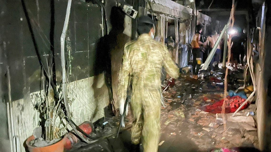 A member of Iraqi security forces walks at Ibn Khatib hospital after a fire caused by an oxygen tank explosion in Baghdad, Iraq, April 25, 2021. (Reuters/Thaier Al-Sudani)