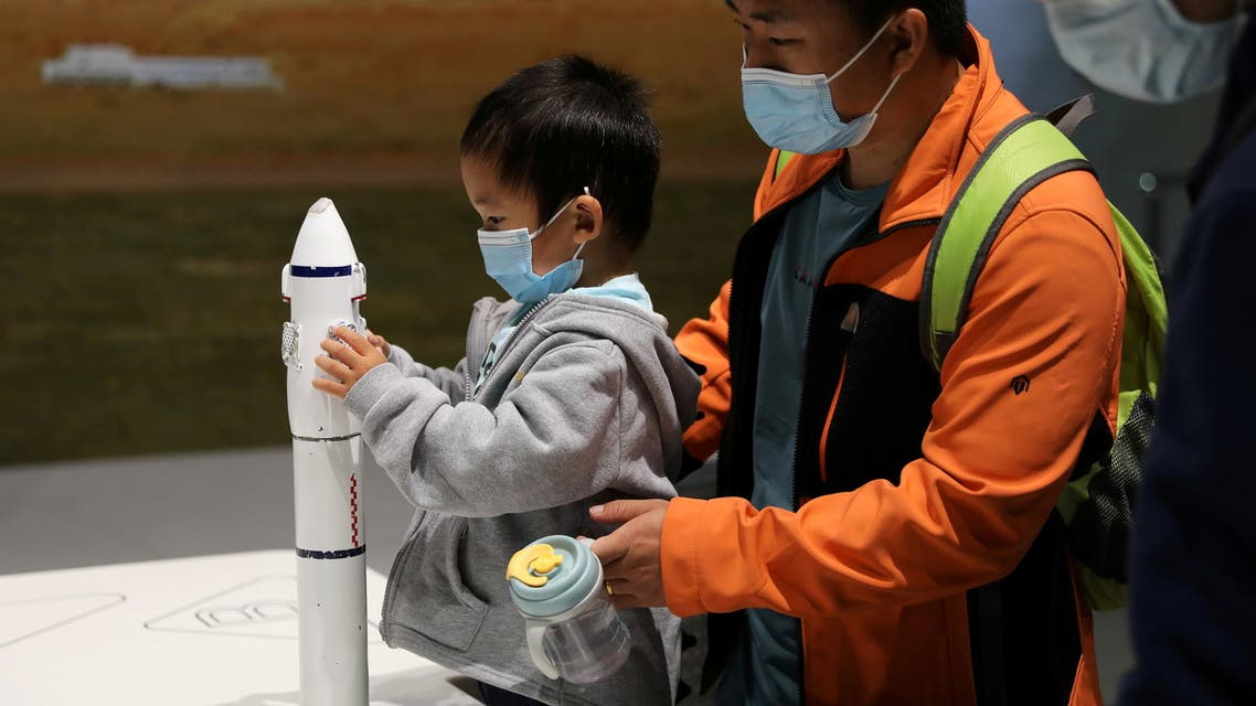 A child holds part of a rocket model at an exhibition featuring the development of China's space exploration on the country's Space Day at China Science and Technology Museum in Beijing, China April 24, 2021. (File photo: Reuters)