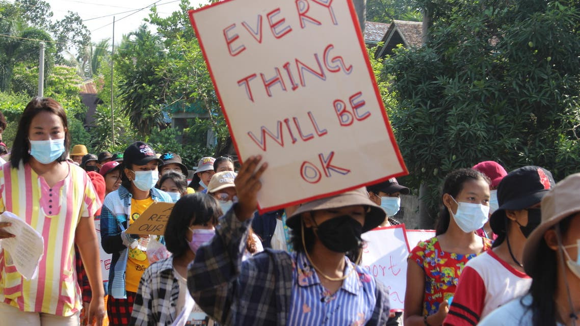 This handout photo taken and released by Dawei Watch on April 26, 2021 shows a protester holding a sign during a demonstration against the military coup in Pandale village in Dawei's Launglone township. (File phoTo: AFP)