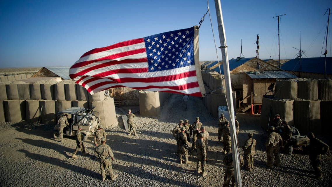 The American flag flies at half mast to remember the victims of 9/11 at Forward Operating Base (FOB) Kuschamond on September 11, 2011. (AFP)