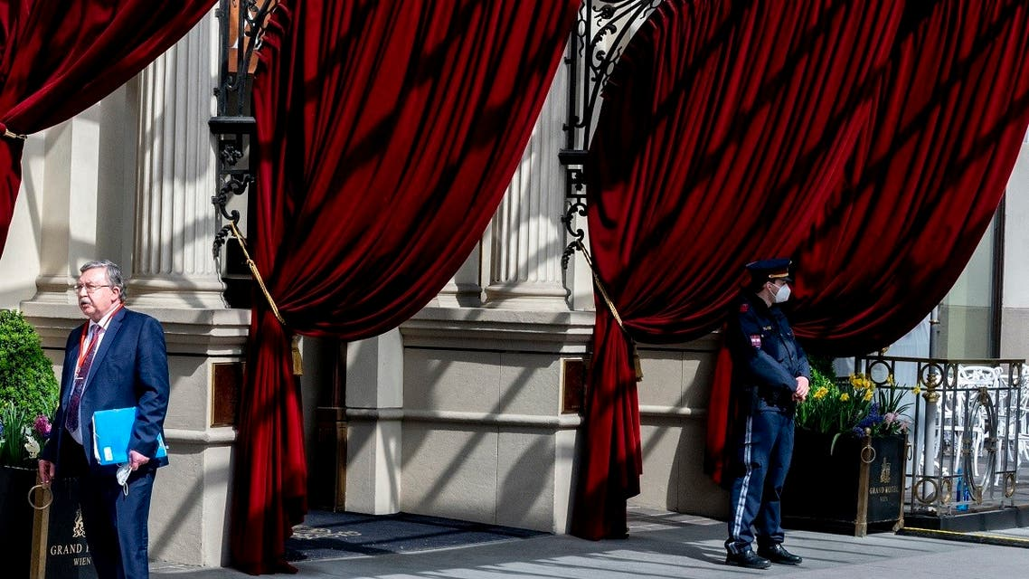 Russia's envoy to the IAEA, Mikhail Ulyanov (L) stands outside to the 'Grand Hotel Wien' for the closed-door nuclear talks with Iran in Vienna, April 27, 2021. (AFP)