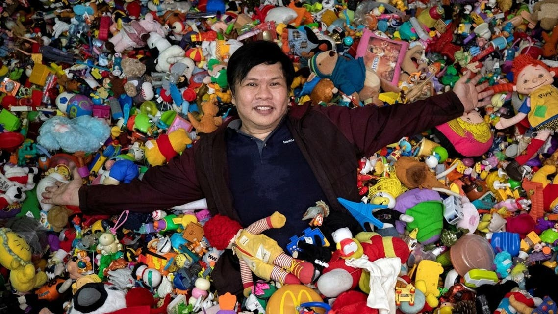 Percival Lugue, who has the Guinness world record for the largest fast-food toy collection, poses with his toy collection in his home in Apalit, Pampanga province, Philippines, on April 20, 2021. (Reuters)