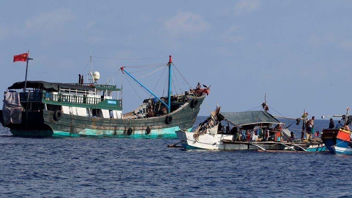 A Chinese fishing vessel is anchored next to Filipino fishing boats at the disputed Scarborough Shoal. (File photo: Reuters)
