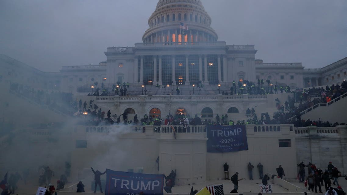Police officers stand guard as supporters of US President Donald Trump gather in front of the US Capitol Building in Washington, US, January 6, 2021. (Reuters)