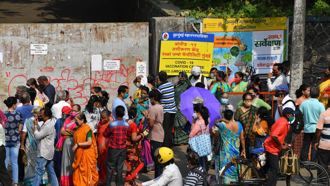 People gather outside an entrance gate of a Covid-19 coronavirus vaccination centre in Mumbai on April 28, 2021. (File photo: AFP)