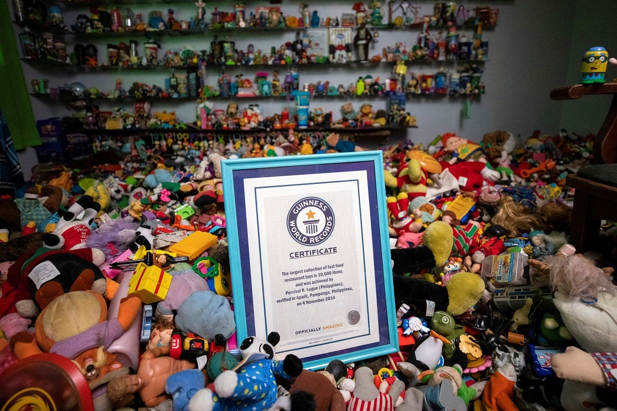 Percival Lugue's certificate for the Guinness world record for the largest fast-food toy collection is photographed with his toy collection in his home in Apalit, Pampanga province, Philippines. (Reuters)