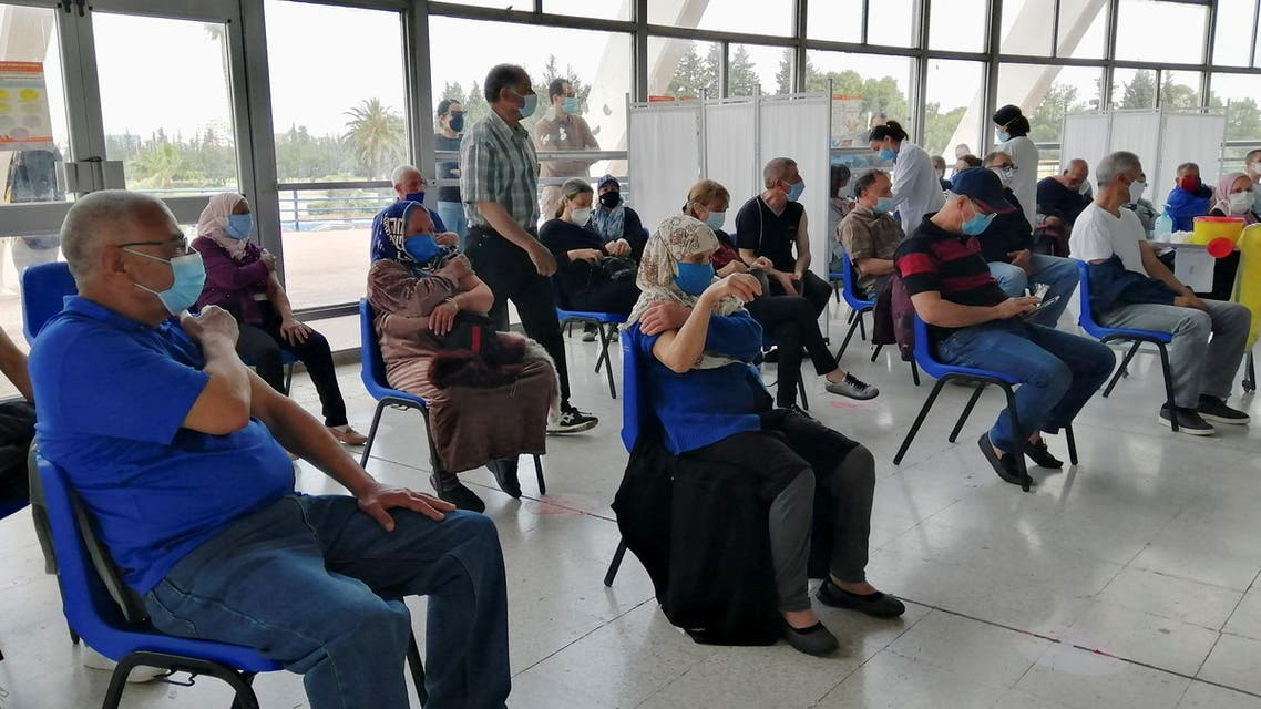 People wait at a coronavirus disease (COVID-19) vaccination centre in Tunis, Tunisia, April 26, 2021. Picture taken April 26, 2021. (File photo: Reuters)