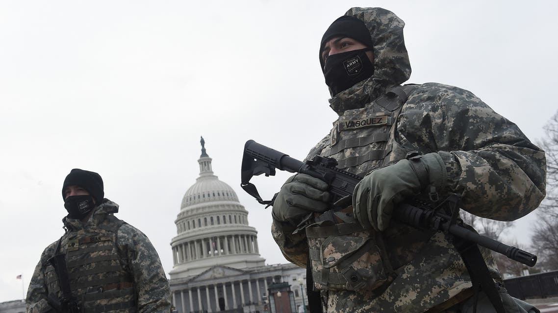 (FILES) In this file photo taken on February 02, 2021 Members of the National Guard get ready for the ceremony honoring Capitol Police officer Brian Sicknick, killed during the January 6 attack on the Capitol Building, in Washington, DC. President Joe Biden has hit some big targets in 100 days, starting with an epic effort to pull the United States from its Covid-19 nightmare, but headaches lie ahead.