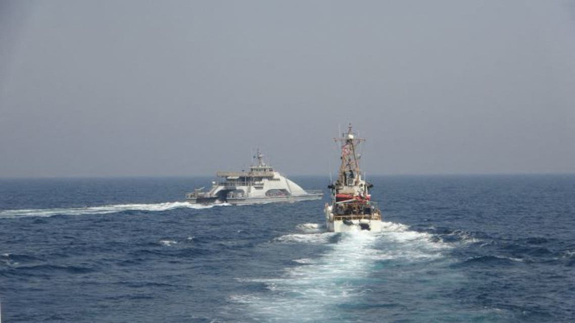 In this handout photo courtesy of US Navy Iran's Islamic Revolutionary Guard Corps Navy (IRGCN) Harth 55 (L) conducted an unsafe and unprofessional action by crossing the bow of the Coast Guard patrol boat USCGC Monomoy (WPB 1326) (R) as the US vessel was conducting a routine maritime security patrol in international waters of the southern Arabian Gulf, April 2, 2021. The USCGC ships are assigned to Patrol Forces Southwest Asia (PATFORSWA), the largest US Coast Guard unit outside the United States, and operate under U.S. Naval Forces Central Command's Task Force 55.
