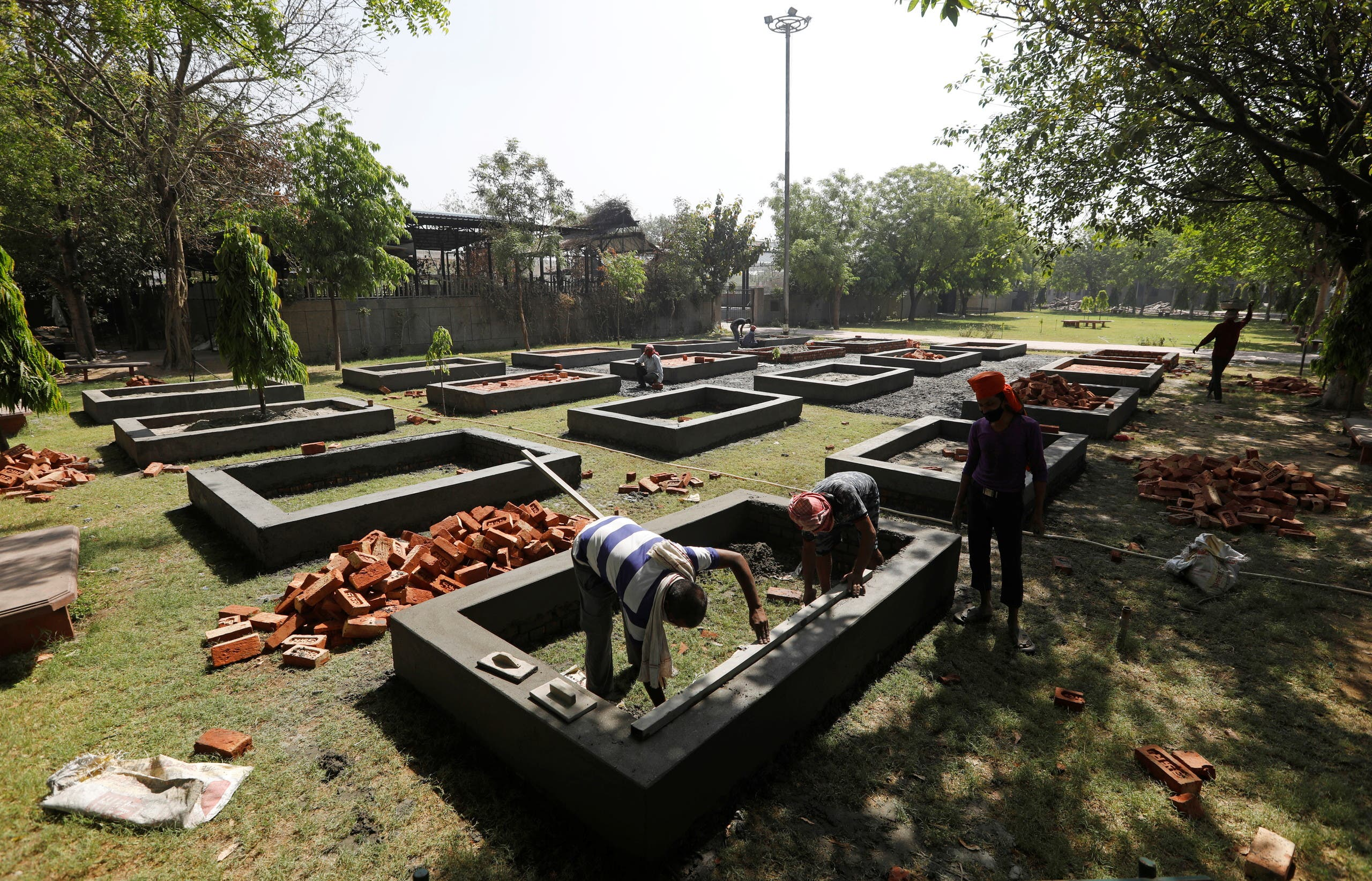 Workers build new platforms to cremate bodies inside a crematorium, amid the spread of the coronavirus disease (COVID-19) in New Delhi, India, April 26, 2021. (Reuters)