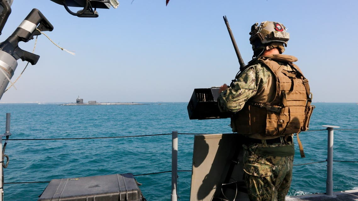 A United States Navy, security personnal stands watch oboard a Mark VI patrol boat while escorting the guided-missile submarine USS Georgia (SSGN 729) through the Gulf, outbound from a sustainment and logistics visit in Manama, Bahrain, in this picture taken December 23, 2020 and released by U.S. Navy (Fifth-Fleet) on December 31, 2020. Spc. Tradale Bryant/U.S. Naval Forces Central Comman/Handout via REUTERS ATTENTION EDITORS- THIS IMAGE HAS BEEN SUPPLIED BY A THIRD PARTY.