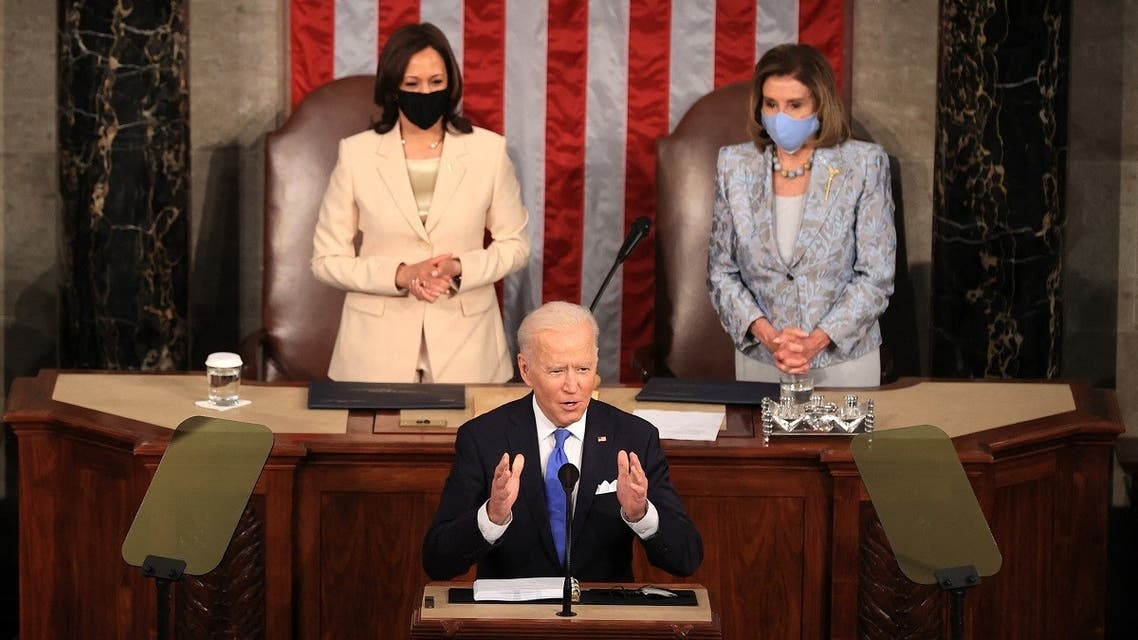 US President Joe Biden addresses a joint session of congress as Vice President Kamala Harris (L) and Speaker of the House US Rep. Nancy Pelosi (D-CA) (R) look on in the House chamber of the US Capitol April 28, 2021 in Washington, DC. (AFP)