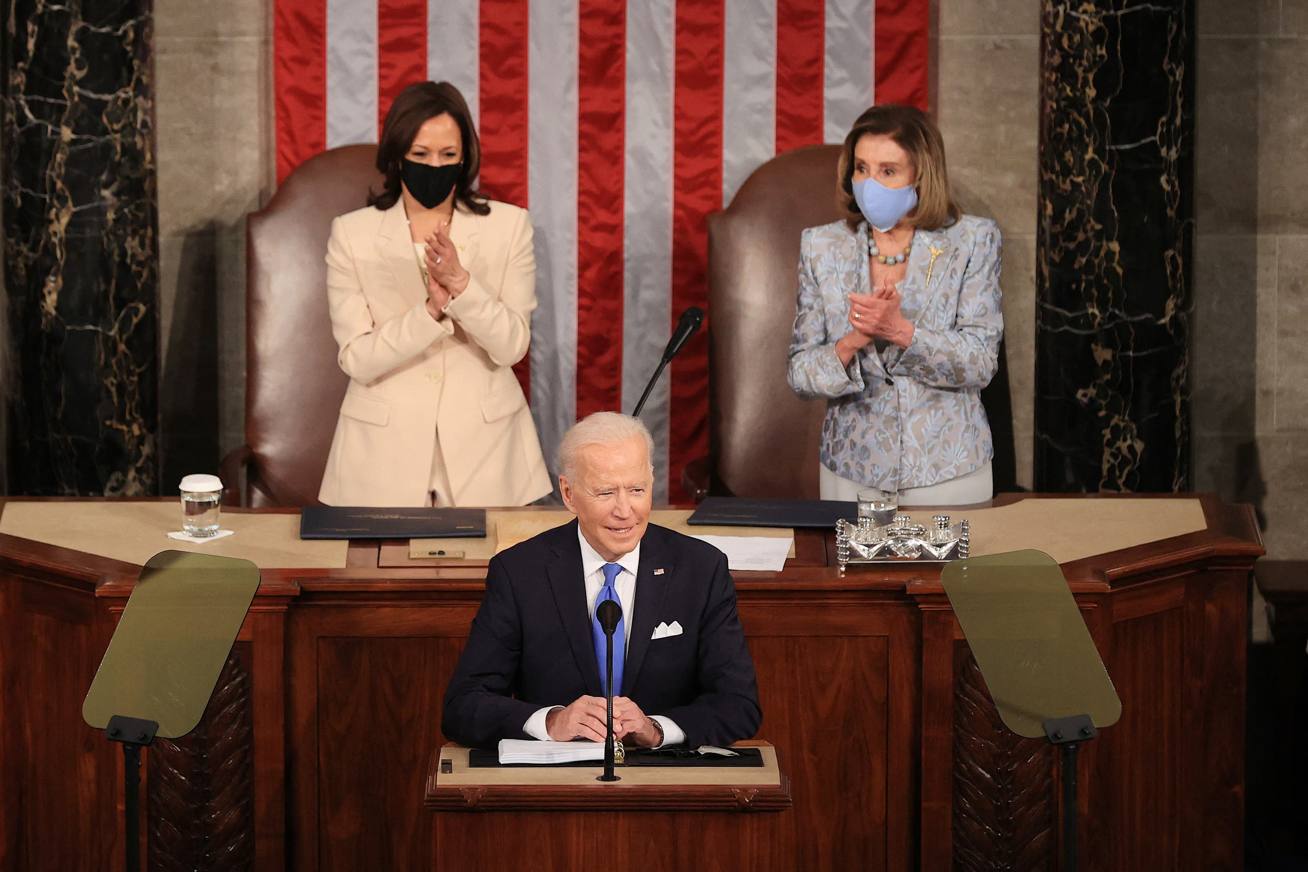 US President Joe Biden, flanked by Vice President Kamala Harris (L) and Speaker of the House Nancy Pelosi, addresses a joint session of Congress at the US Capitol in Washington, DC, on April 28, 2021. (AFP)