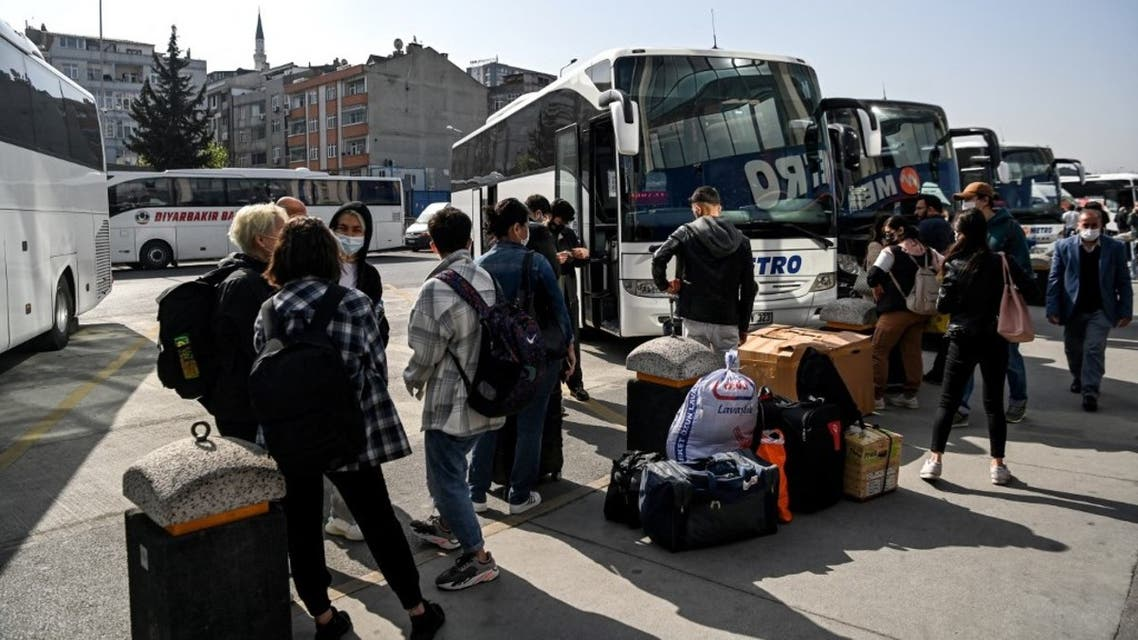 Travellers wait to board their buses as they leave the city from the Esenler national bus station in Istanbul on April 29, 2021, 12 hours ahead of a new full lockdown aiming at fighting a surging third wave of Covid-19, coronavirus infections. (AFP)