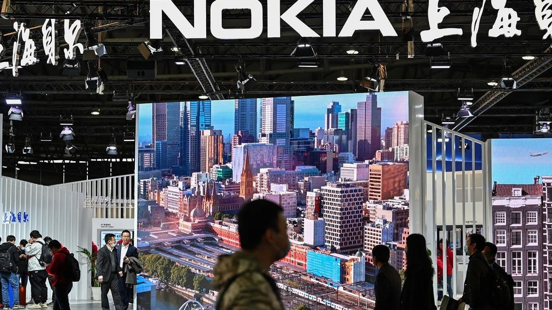 People walk past the Nokia booth during the Mobile World Congress in Shanghai on February 23, 2021. (AFP)