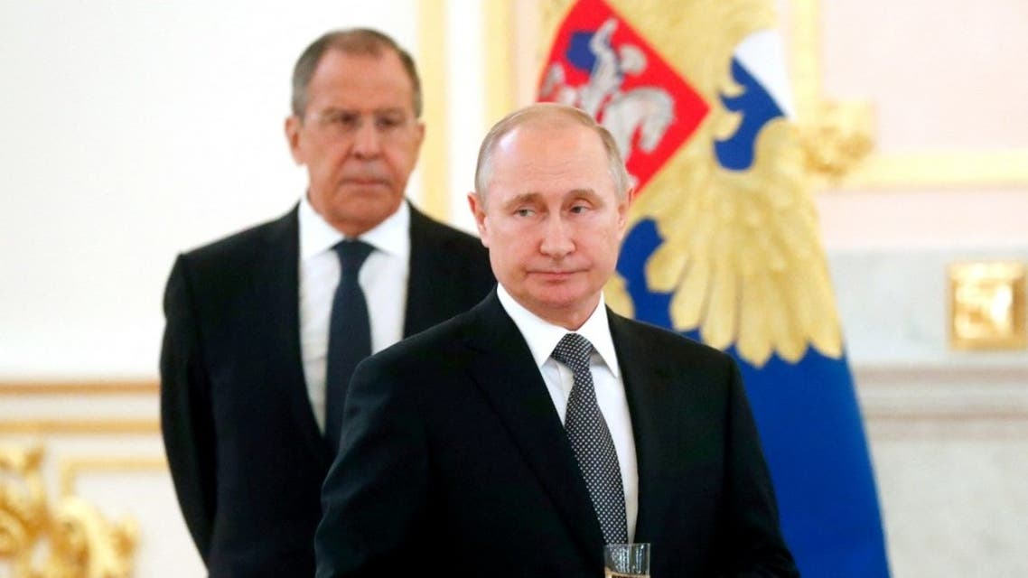 Russian President Vladimir Putin (R) and Russian Foreign minister Sergei Lavrov attend the ceremony for the presentation of ambassador's credentials at the Kremlin in Moscow on July 3, 2019. (Reuters)