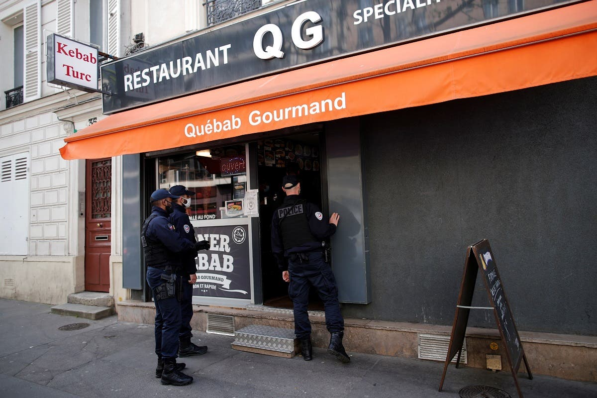 Police officers make a routine check in restaurants to verify compliance with COVID-19 sanitary measures in Vincennes, near Paris, amid the coronavirus outbreak in France, on April 29, 2021. (Reuters)