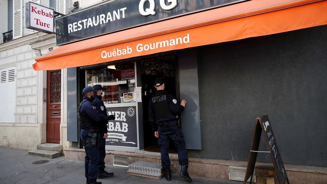 Police officers make a routine check in restaurants to verify compliance with COVID-19 sanitary measures in Vincennes, near Paris, amid the coronavirus outbreak in France, April 29, 2021. (Reuters)