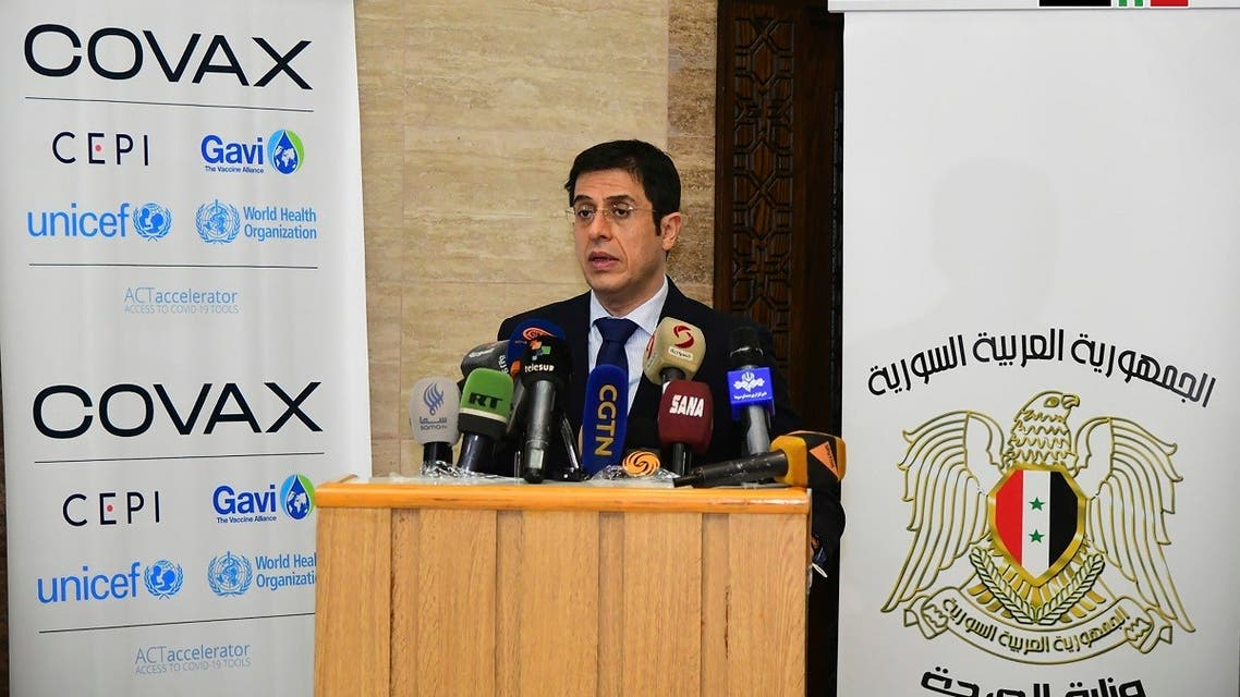 Syria's Health Minister Hassan Ghabbash, during a press conference where he announced receiving the first batch of AstraZeneca Covid-19 vaccines, in Damascus, Syria, on April 22, 2021. (AP)