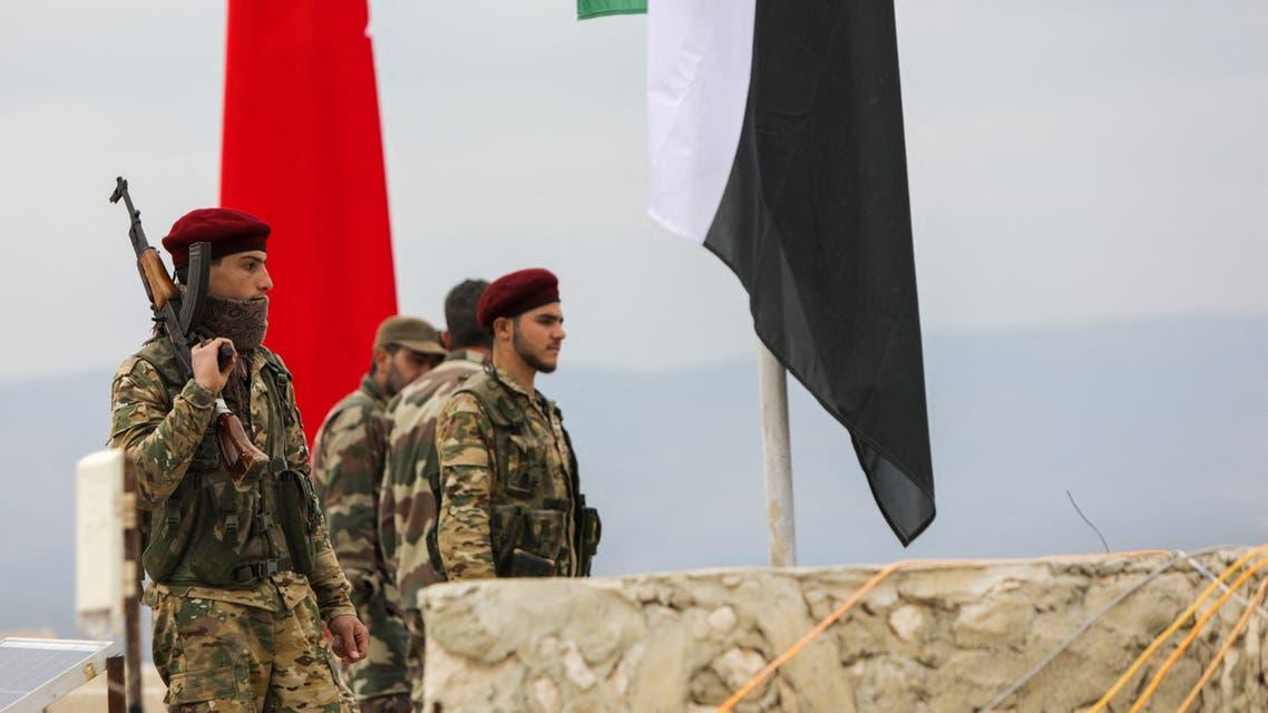 عناصر من الفصائل السورية المسلحة المدعومة من تركيا في عفرين (أرشيفية- فرانس برس)