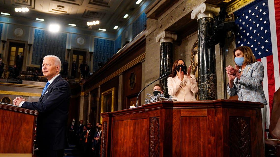 President Joe Biden addresses a joint session of Congress, with Vice President Kamala Harris and House Speaker Nancy Pelosi (D-Calif.) on the dais behind him, in Washington, U.S., April 28, 2021. Melina Mara/Pool via REUTERS
