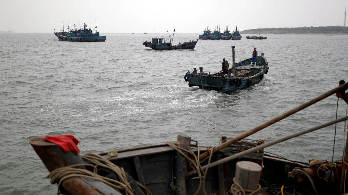 FILE PHOTO: Fishing boats are seen off the coast of Qingdao, Shandong province, China, following an oil spill in the Yellow Sea caused by a collision between tanker A Symphony and bulk vessel Sea Justice off Qingdao port, April 28, 2021. (File Photo: Reuters)