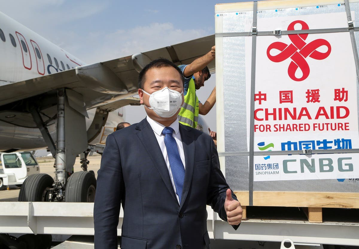 A member of the Chinese delegation gestures as a batch of China's Sinopharm coronavirus disease (COVID-19) vaccine arrives as a donation at the airport in Damascus, Syria April 24, 2021.  (Reuters)
