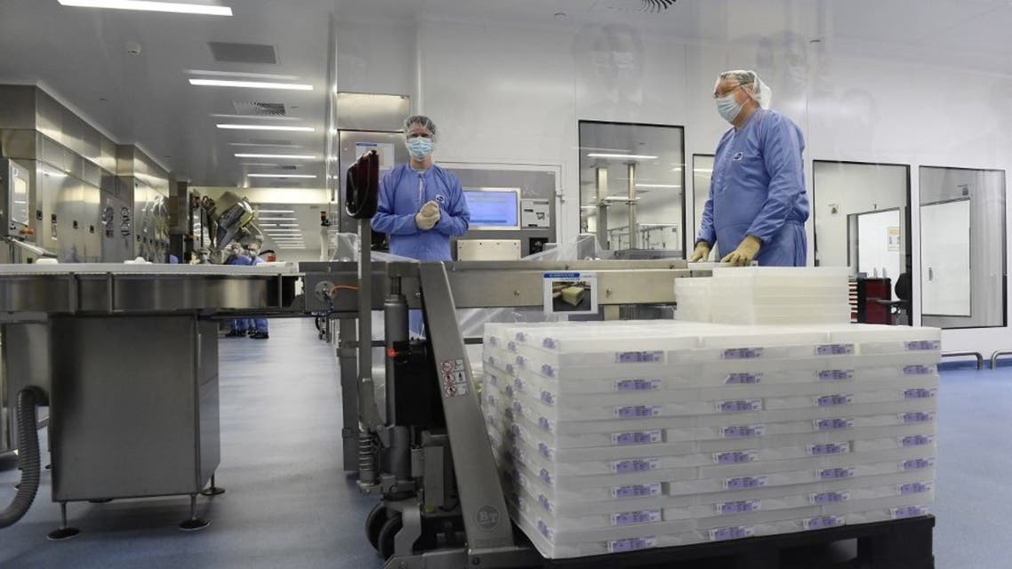 Employees are at work at the factory of US multinational pharmaceutical company Pfizer in Puurs. (AFP)
