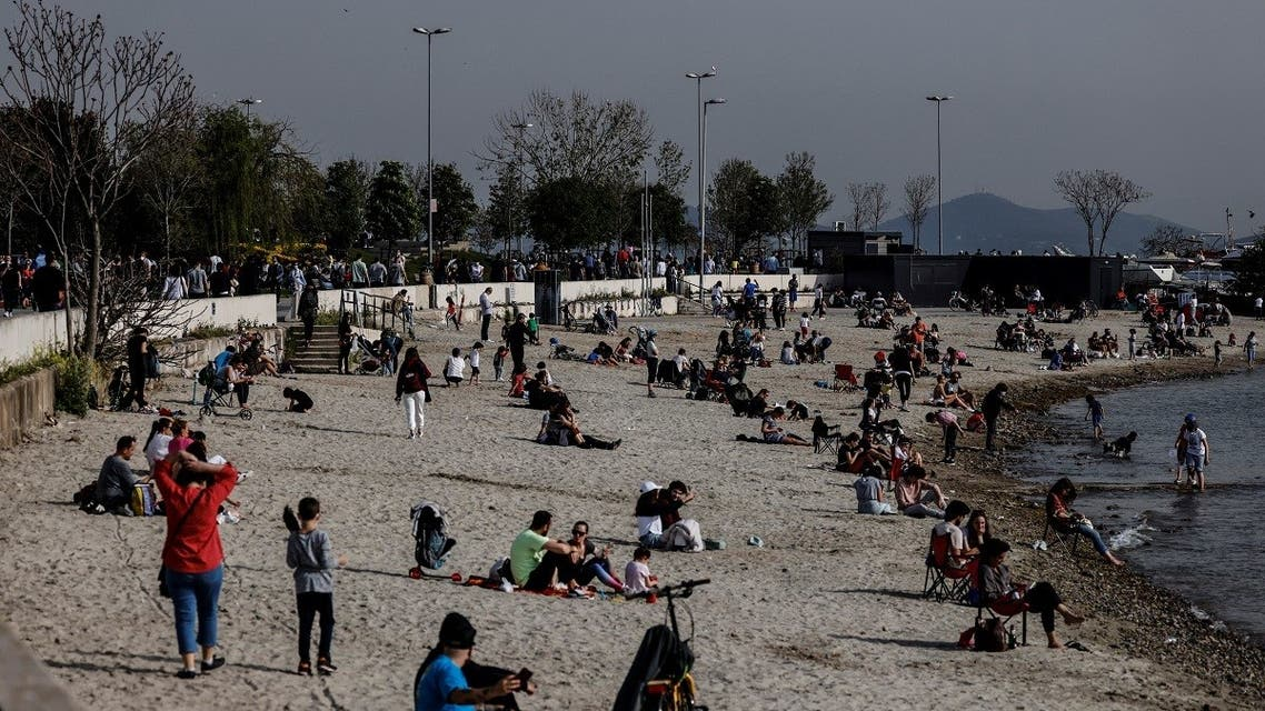 """People enjoy a warm and sunny day the beach a few hours before the start of a nationwide """"full closure"""" until May 17 including a continuous lockdown amid the spread of the coronavirus disease (COVID-19), in Istanbul, Turkey, on April 29, 2021. (Reuters)"""