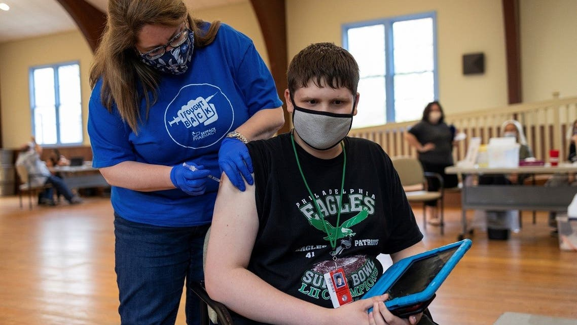 Thomas Macconnell, 16, who is on the autism spectrum, receives a coronavirus disease vaccine in Worcester, Pennsylvania, US, on April 29, 2021. (Reuters)