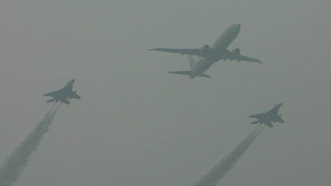 An Indian Navy Boeing P-8I Poseidon anti-submarine warfare and maritime patrol aircraft (C) flies in formation with Indian Navy MiG-29K carrier-capable multirole fighter aircraft during a flypast for the country's Republic Day Parade in New Delhi on January 26, 2015. (File photo: AFP)