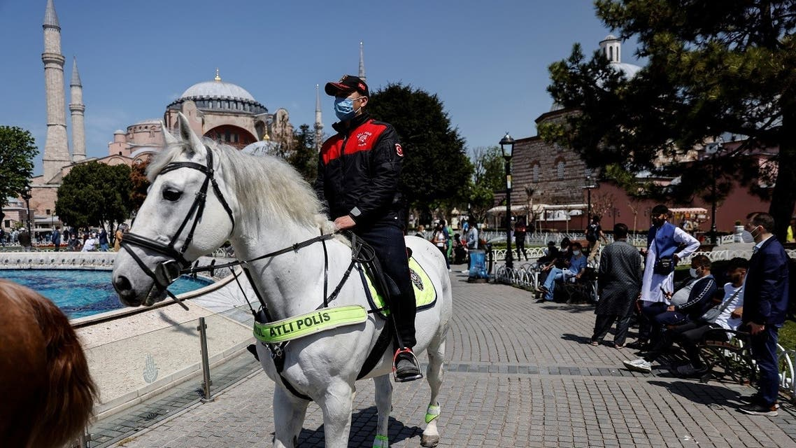 """Mounted police officers ride around the Ayasofya-i Kebir Camii or Hagia Sophia Grand Mosque during a nationwide """"full closure"""" until May 17 including a continuous lockdown amid the spread of the coronavirus, in Istanbul, Turkey, on April 30, 2021. (Reuters)"""