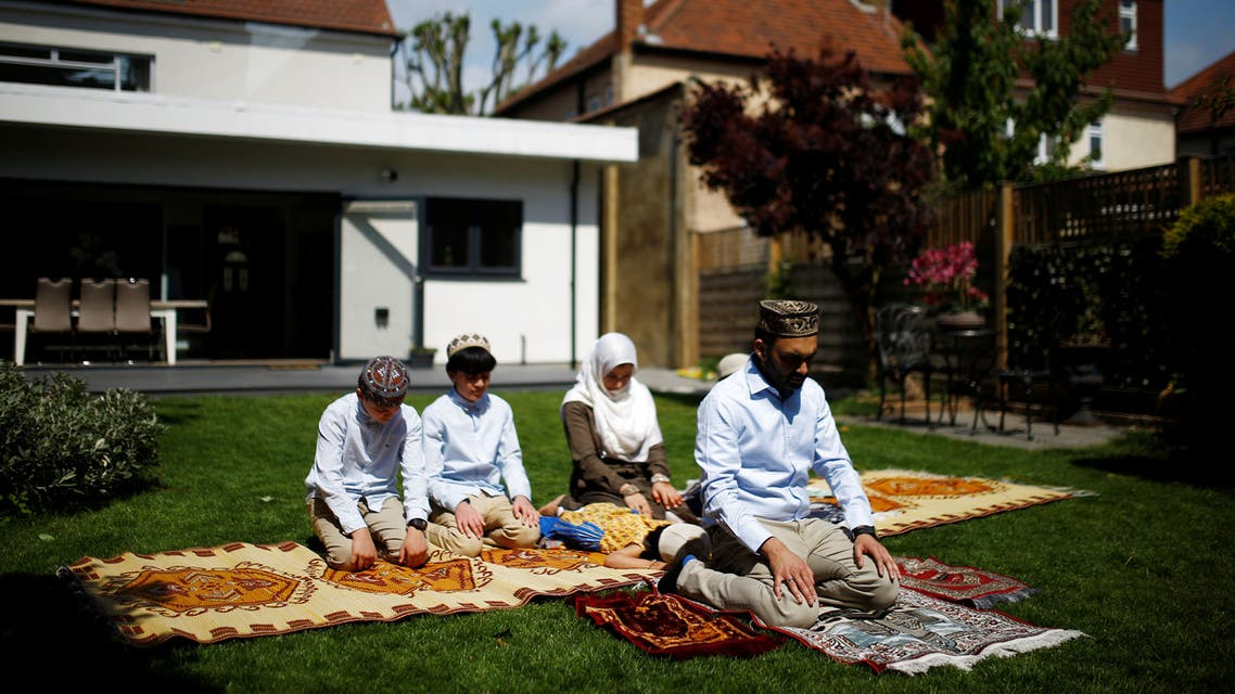 Muslim family Farood Ahmed with his wife Sana and sons Zaine, Rayan, Usman and daughter Inaya in their garden offer Eid al-Fitr prayers at home to mark the end of the month of Ramadan in Surbiton, London, following the outbreak of the coronavirus disease (COVID-19), London, Britain, May 24, 2020. (Reuters)