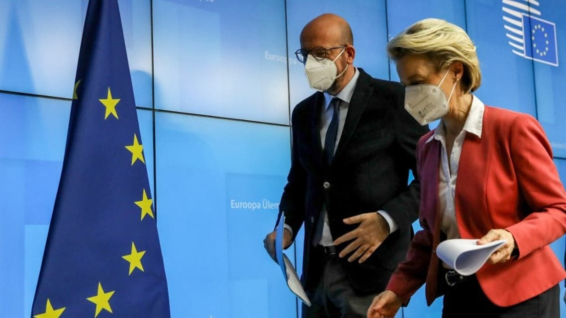 European Commission President Ursula von der Leyen (R) and European Council President Charles Michel leave after a joint press conference in Brussels, on February 25, 2021. (AFP)