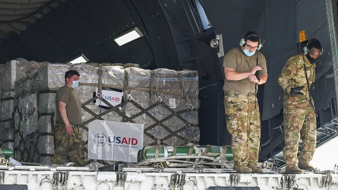 US army personnel prepare to unload coronavirus relief supplies from the U.S. at the Indira Gandhi International Airport cargo terminal in New Delhi, India, on April 30, 2021. (Reuters)