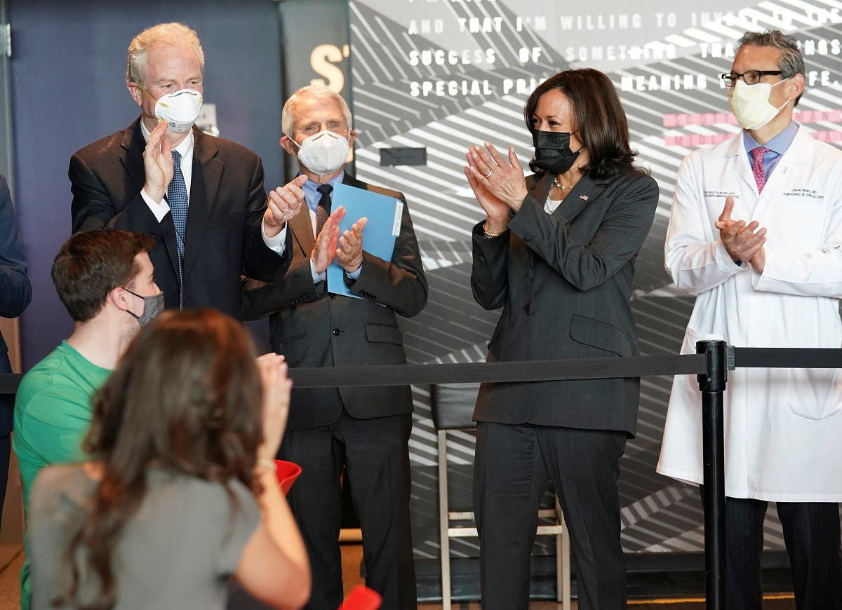 US Vice President Kamala Harris applauds healthcare workers while touring a COVID-19  mass vaccination site with Dr. Anthony Fauci and Senator Chris Van Hollen (D-MD) at M&T Bank Stadium in Baltimore, Maryland, US, on April 29, 2021. (Reuters)