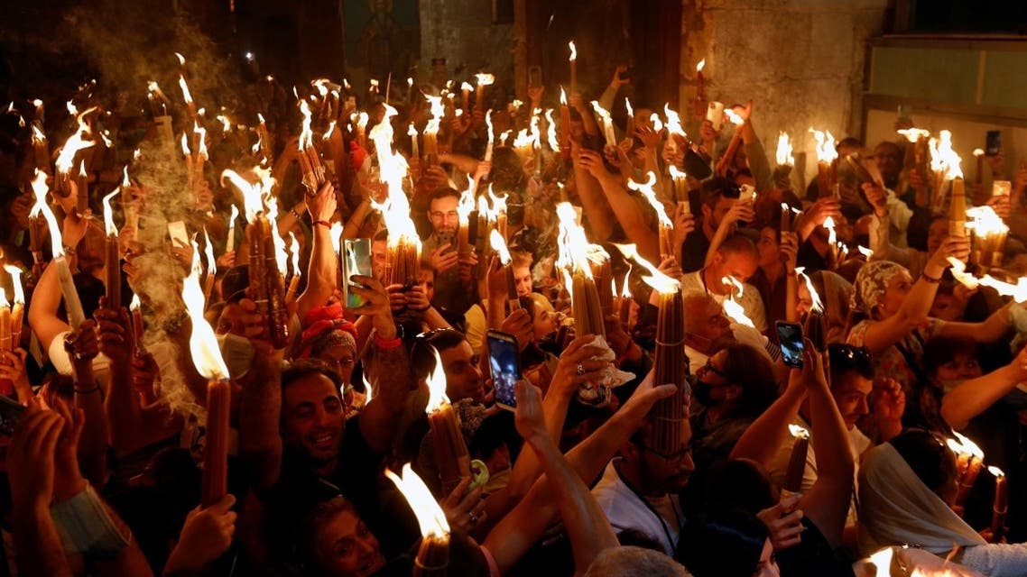 Orthodox Christian worshippers attend the Holy Fire ceremony amid eased coronavirus restrictions at the Church of the Holy Sepulchre in Jerusalem's Old City, May 1, 2021. (Reuters/Corinna Kern)