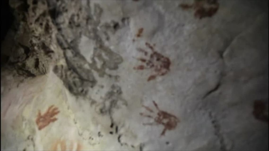 Various of hand prints on cave that are reportedly 1,200 years old. (Reuters)