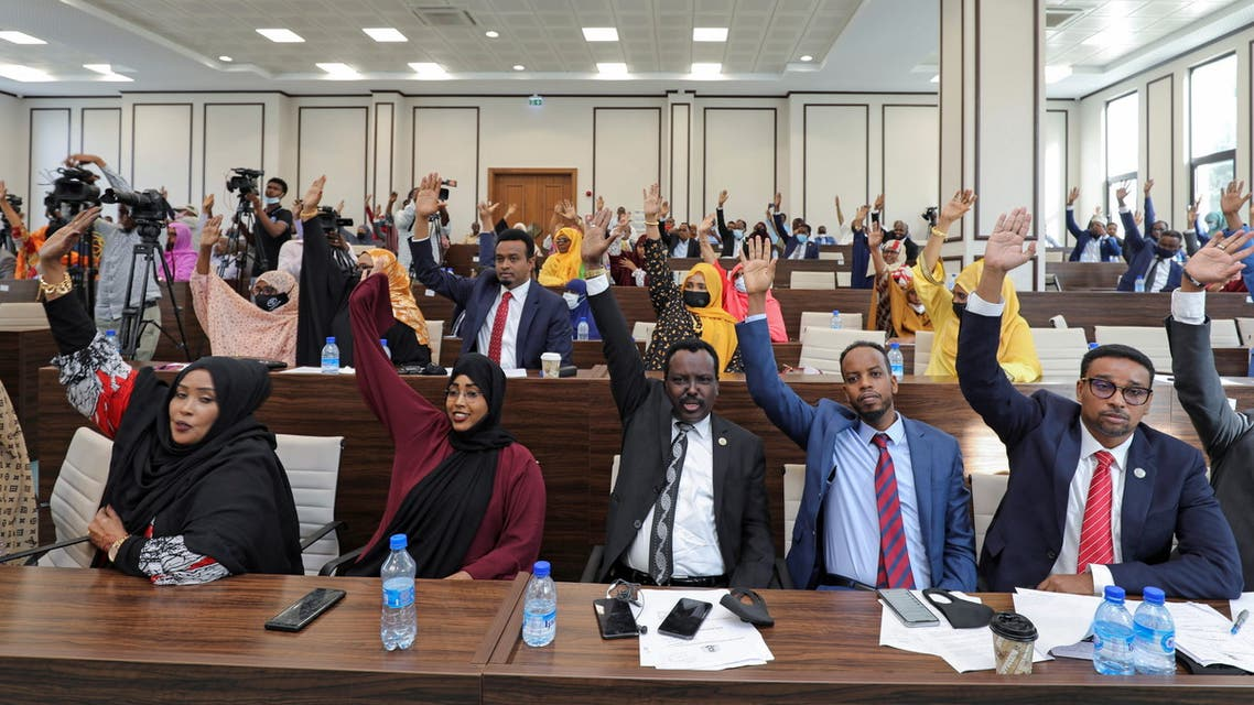 Somali legislators of the lower house of parliament raise their hands to vote to extend President Mohamed Abdullahi Mohamed's term for another two years to let the country prepare for direct elections, in Mogadishu, Somalia April 12, 2021. (Reuters)