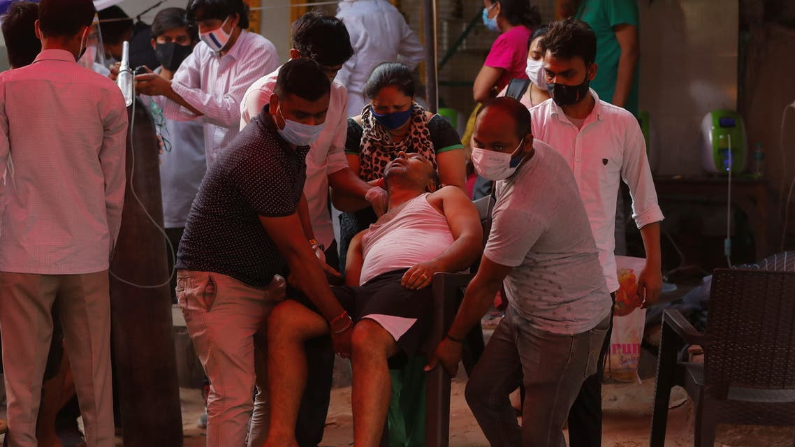 People carry the father of Manisha Bashu towards an ambulance, after he felt unconsicous while receiving oxygen support for free at a Gurudwara (Sikh temple), amidst the spread of coronavirus disease (COVID-19), in Ghaziabad, India, April 30, 2021. (Reuters)